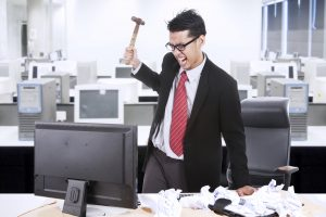 bigstock-Angry-Businessman-Throw-Hammer-39759850